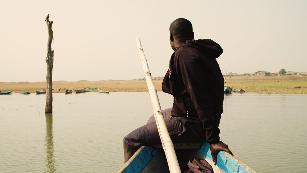 Kwame on rescue boat approaching shore.jpg