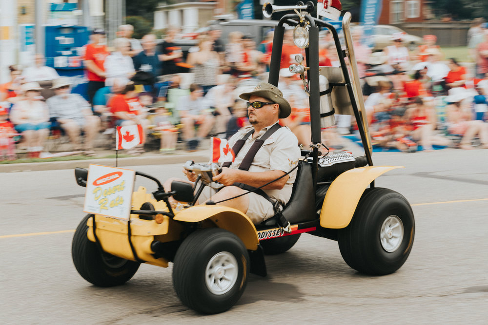 Miniature dune buggy whistles down King St. during Canada's 150th celebration parade in Cambridge.