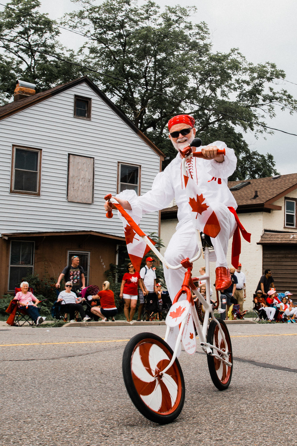 Entertainer rides a unique bicycle in Canada's 150th celebration parade in Cambridge.
