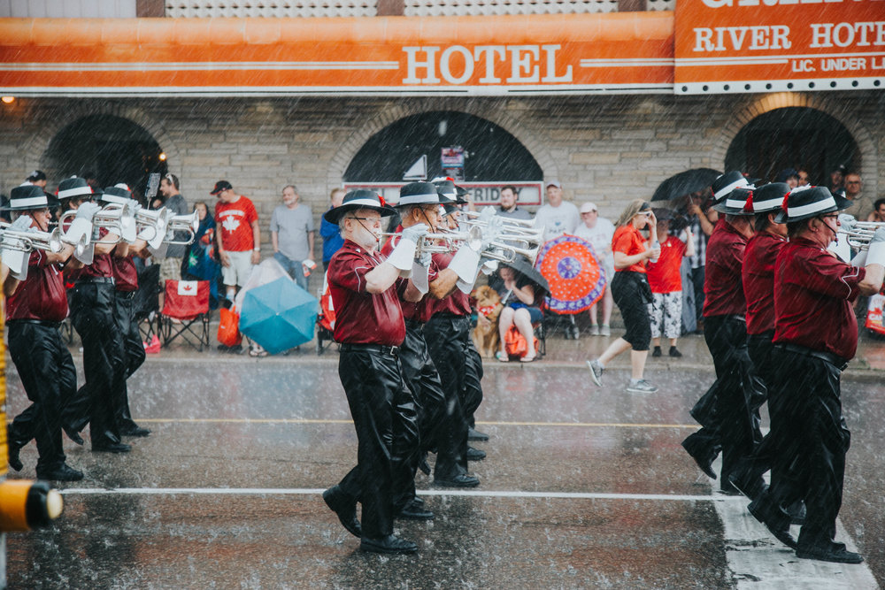 Scout House band gets caught in rain during downpour on Cambridge Canada day celebrations.