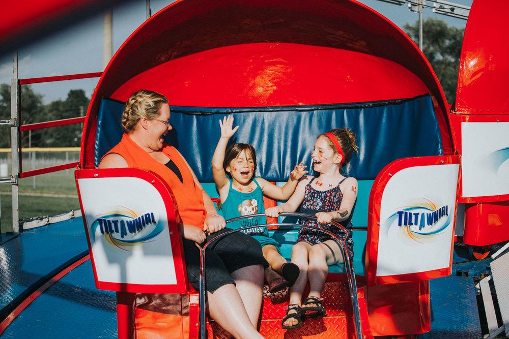 Amusement park rides at Riverside Canada Day celebration.