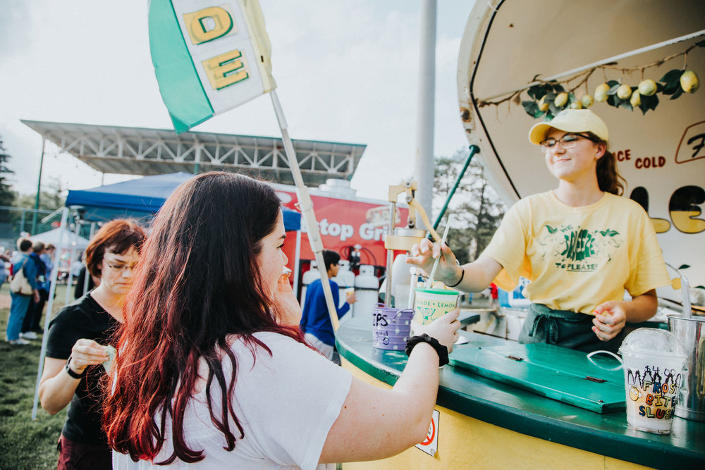 Carly grabs a refreshing Lemonade during the Riverside carnival celebrations.