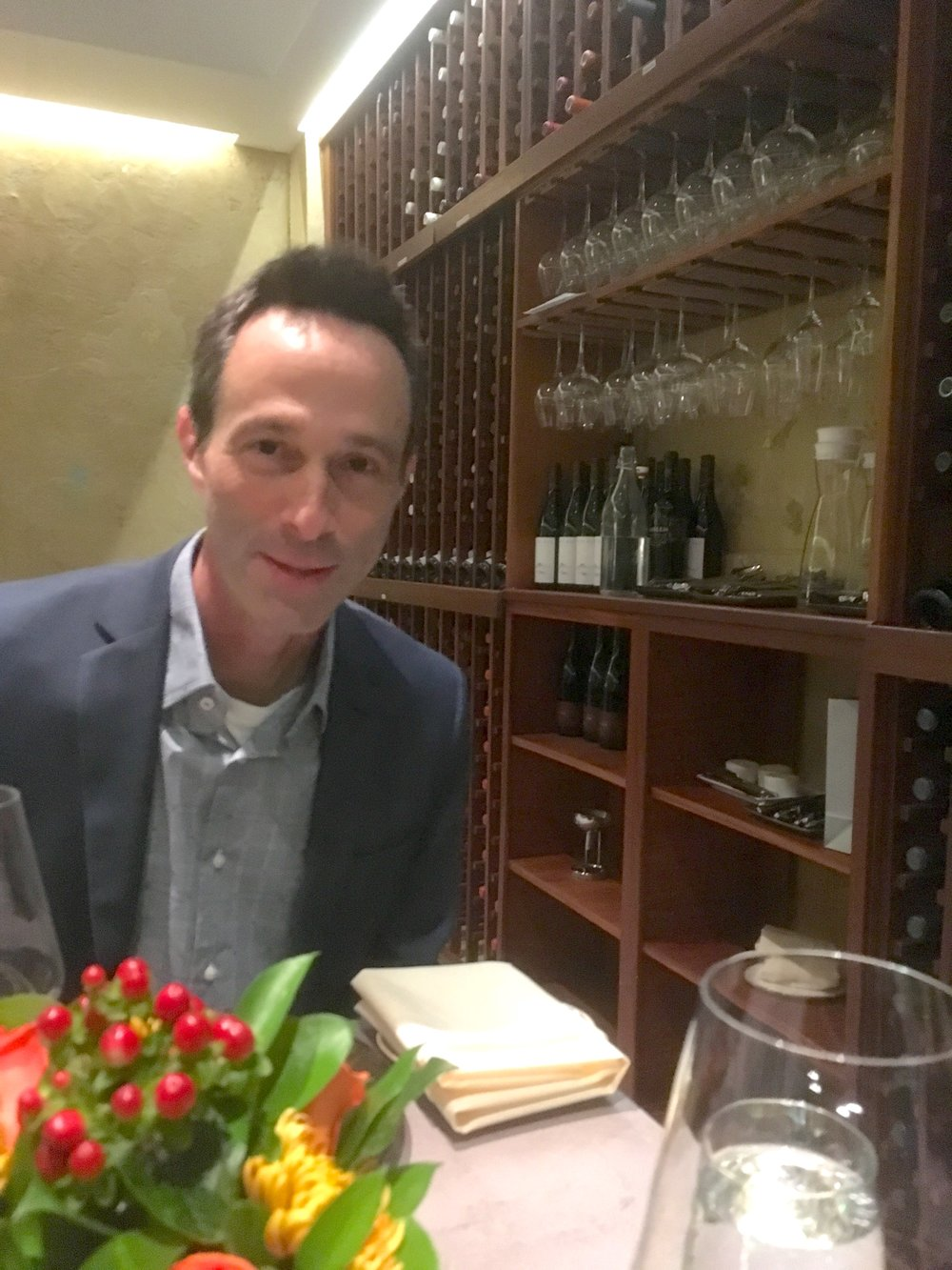 Mark makes for a very handsome dinner date and looks quite at home in Clarity's kitchen-view cellar.