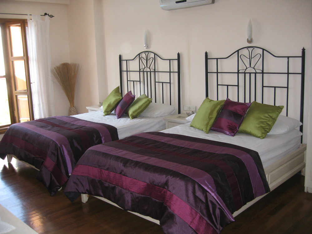 Poppy Villa Purple Room Double Beds.JPG