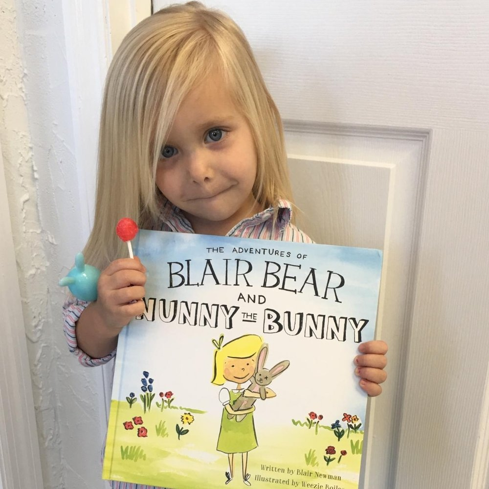 Proud owner of her very own signed copy of The Adventures of Blair Bear and Nunny the Bunny!