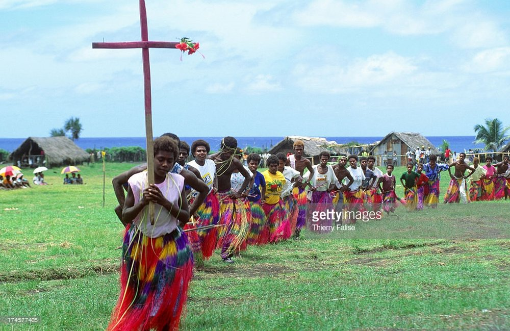 Members of the John Frum Cargo Cult in a procession on Tanna