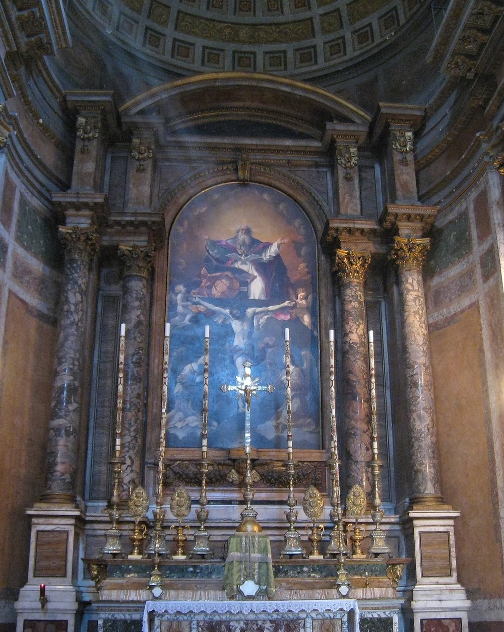 The high altar in Santissima Trinita dei Pellegrini at a moment when a ray of sunlight is on the crucifix