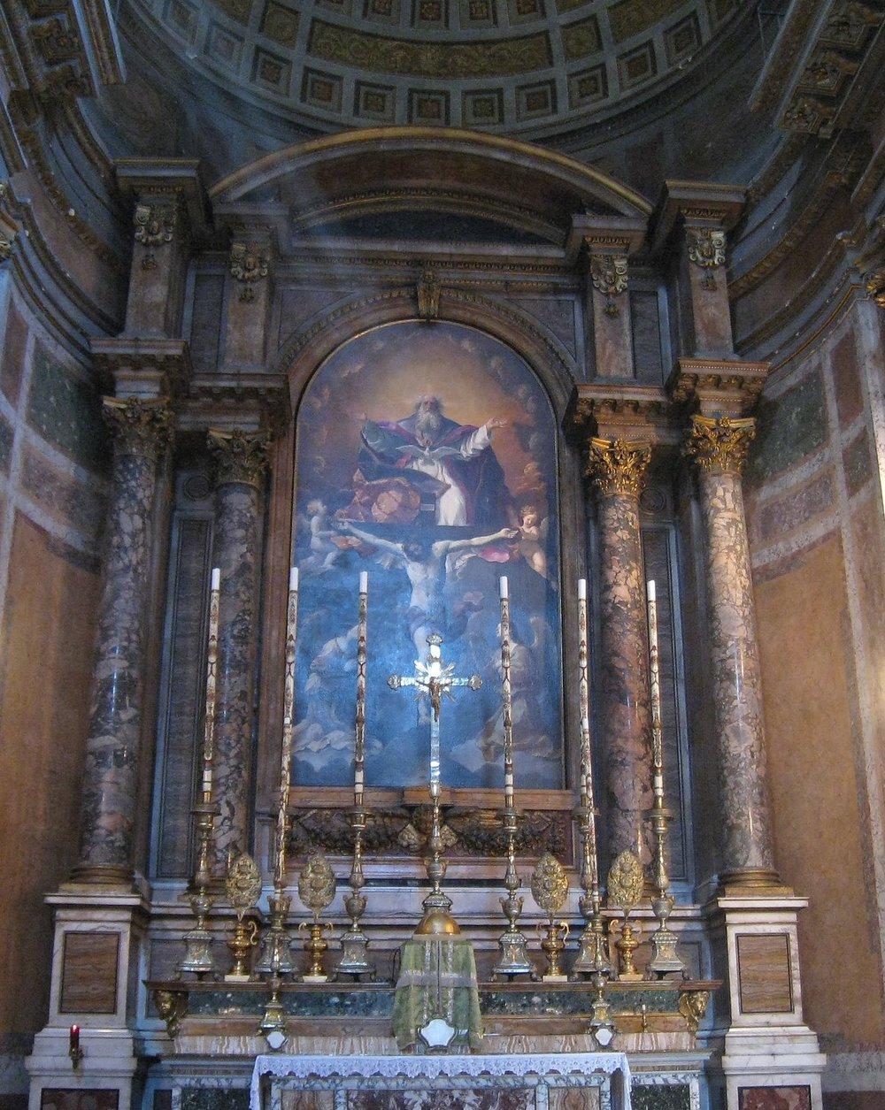 The high altar in Santissima Trinita dei Pellegrini at a moment when a ray of sunlight is on the crucifix