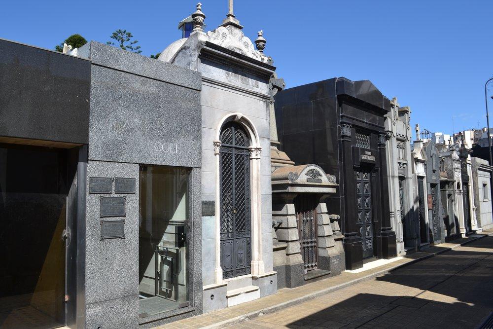 Modern mausoleums next to older mausoleums