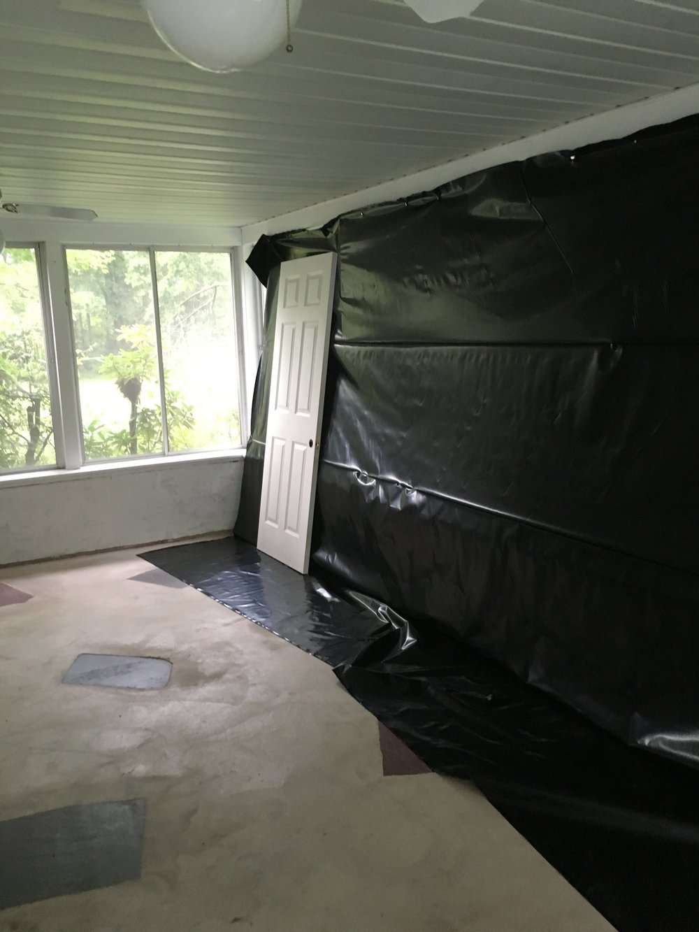 One of the first projects that we took on prior to moving in was re-painting all of the doors in the house. The sunroom was our staging area for all of the paint! Our first house purchase was literally a roll of black plastic to cover up the windows while we sprayed the doors.
