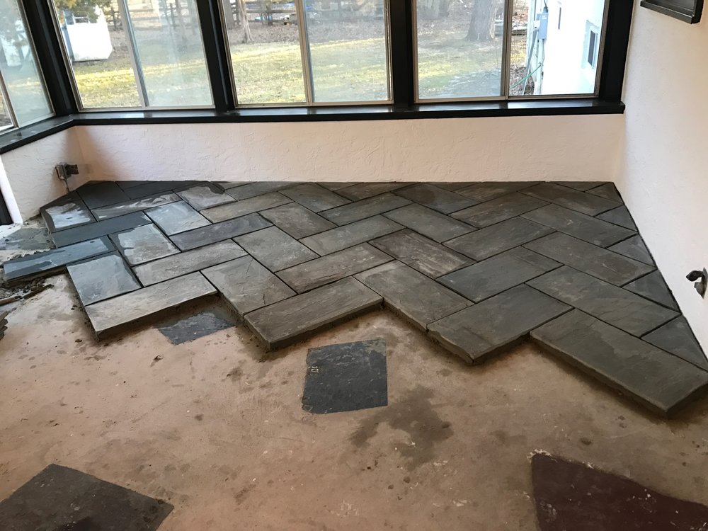 After the ceiling was complete, it was on to the floors. I was dying to have a herringbone somewhere in the house, and we decided this was just the place for it.
