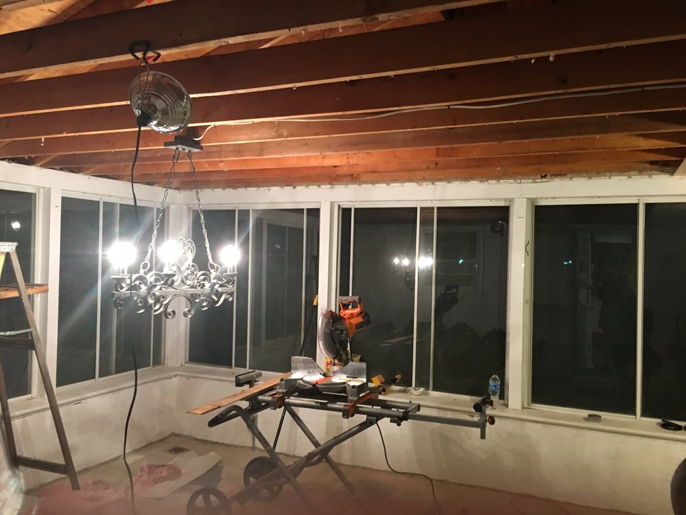 Fast forward a few months to December!  The room had remained a trash/staging/storage area while we had been working on our kitchen and other projects inside. We already had to cut through the aluminum ceiling for another project, so one day while I was at work, Mike ripped out THE WHOLE CEILING.  WITHOUT CONSULTING ME.