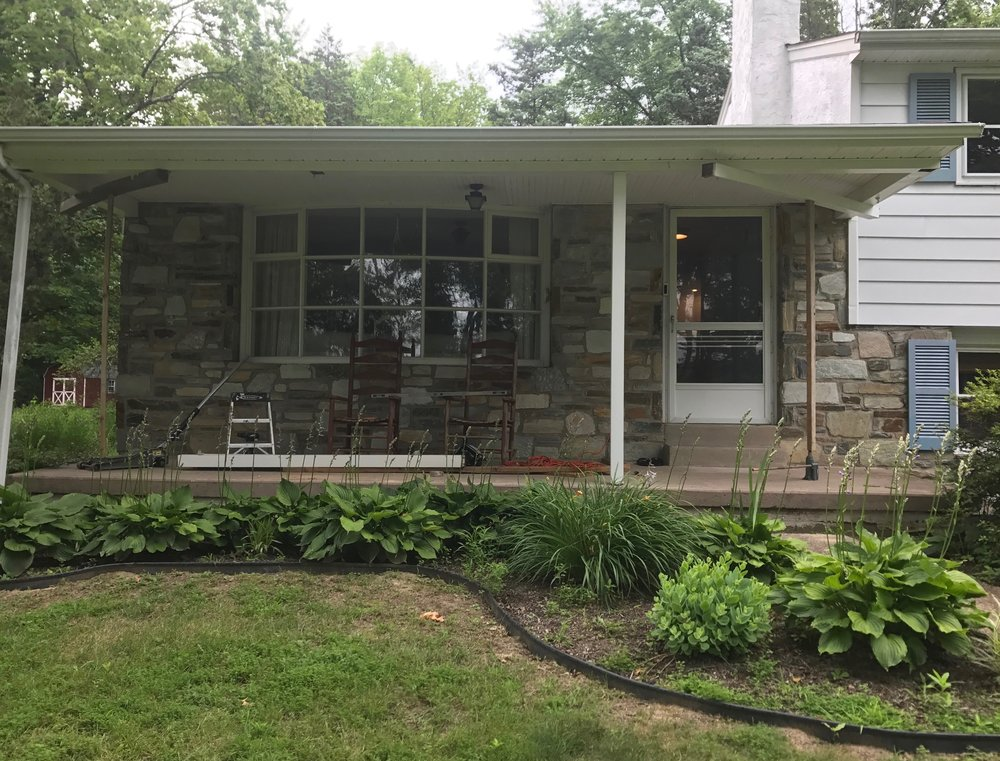 Here's the before! Phase 1 of the project was covering up the concrete porch. We would add stone to the front of the porch to match the house and bluestone to the top surface.