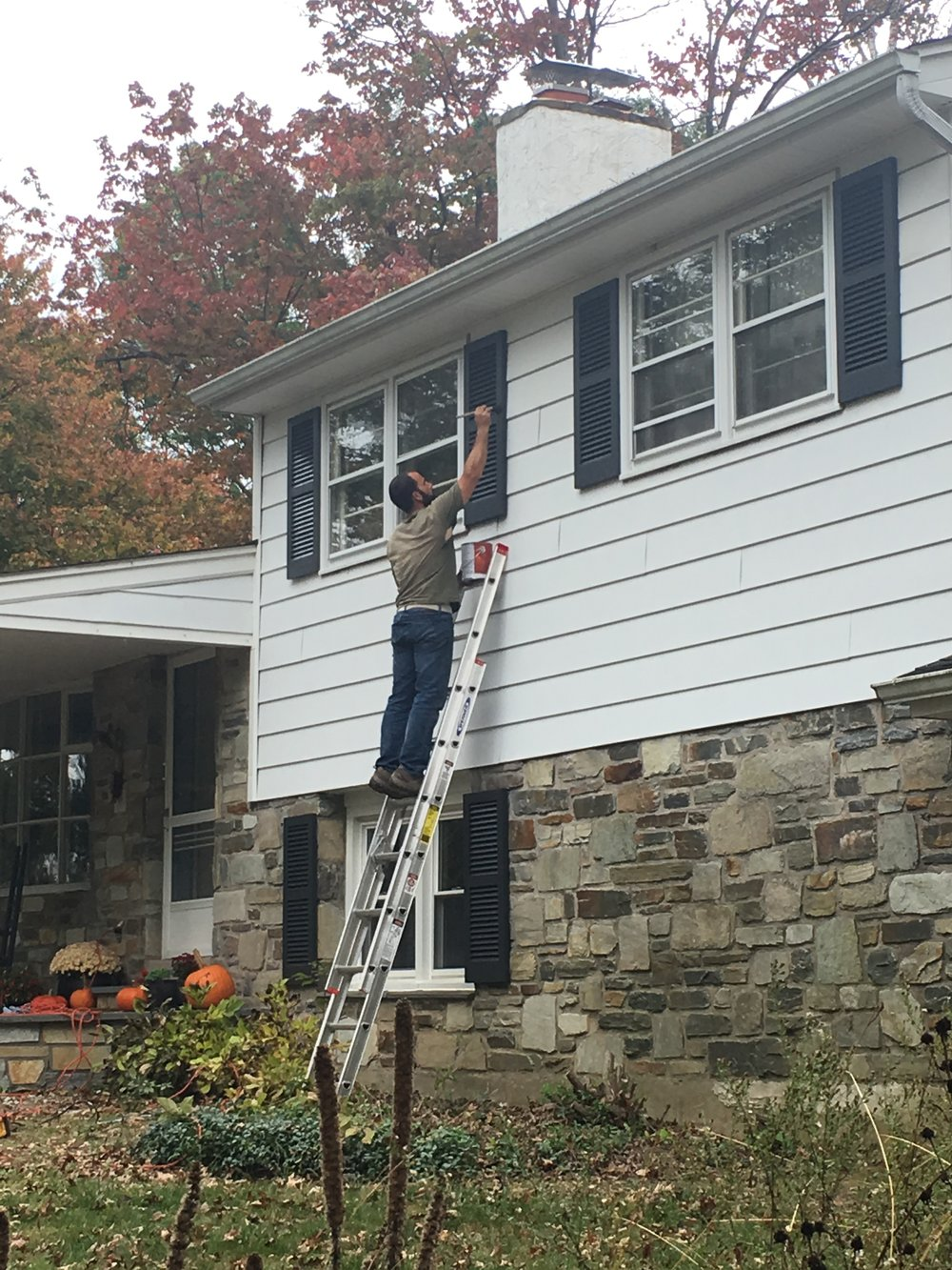 In October 2017, we were back at it! We decided to paint the shutters a darker color; Benjamin Moore Wrought Iron.