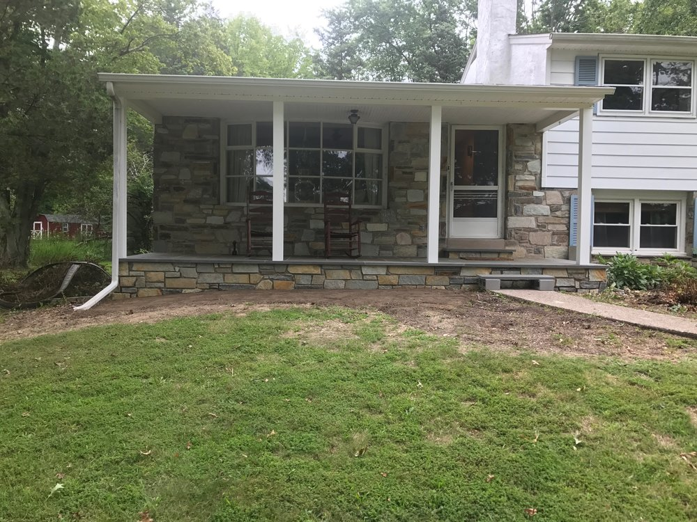 We also pulled the old landscaping out so we could start over with a new bed layout and plantings. Here you can see how the stone that was added to the porch matches the house. You can also see my least favorite feature that we rocked for a year after this picture; a cinder block step! This portion of the project was wrapped up in August 2017.