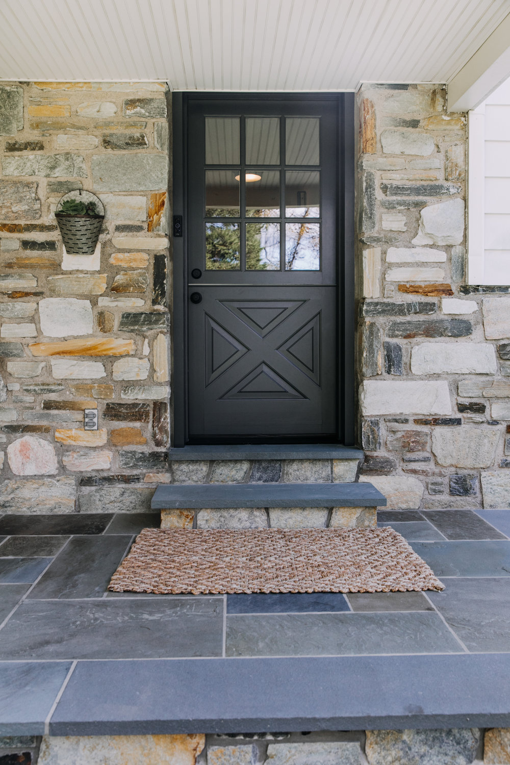 Fast forward to October! We ordered a dutch door from   Niece Lumber   .  We then painted the door to match the shutters and had it installed by our friend Tim at   New Hope Remodeling   .  Mike also updated the front door steps with the same stone from the house and with matching flagstone from the porch.