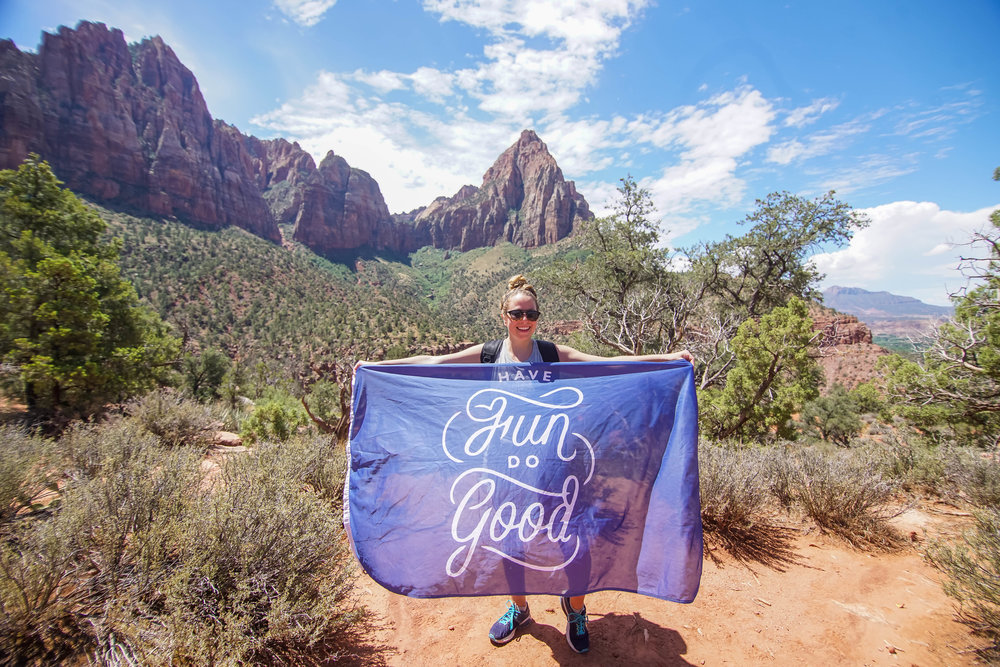 Lisa Press raising the Have Fun Do Good Flag