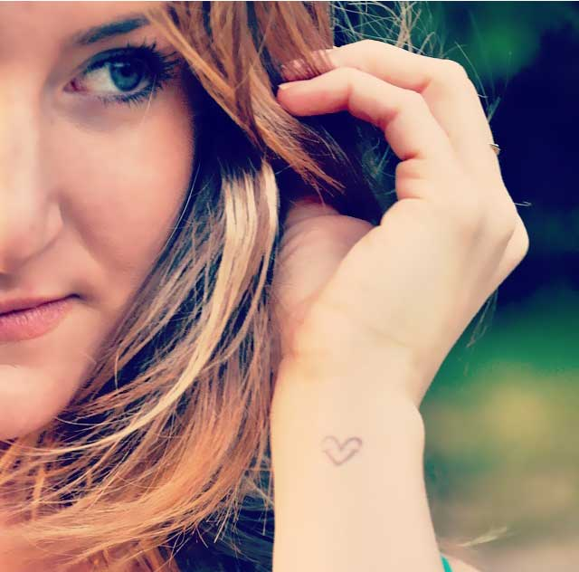 Standing Light founder Leyal Salvade with her logo tattoo
