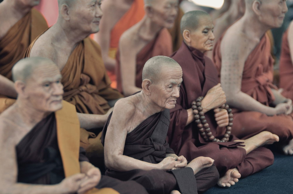 Monks meditating with their eyes open