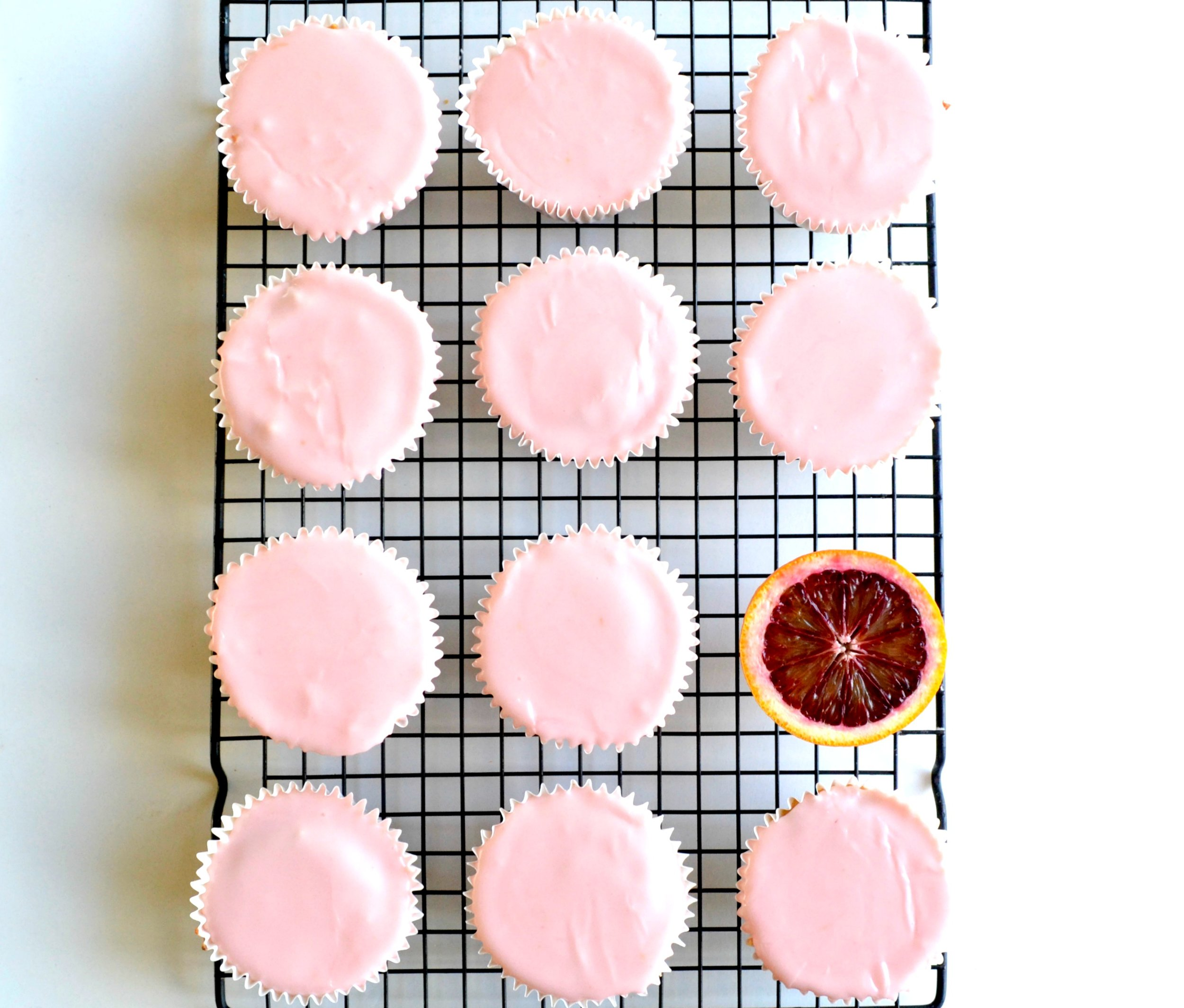 Blood oranges are in season. These blood orange fairy cakes or cupcakes are beautifully zingy with the addition of zest and juice from the orange.