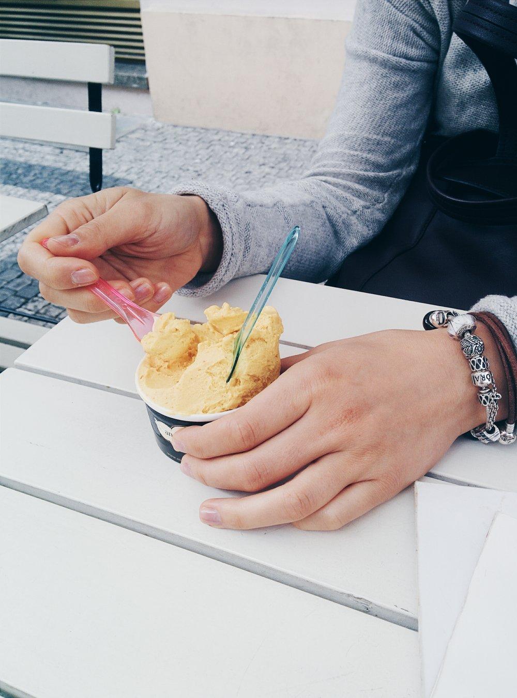 foodiesfeed.com_girl-eating-icecream-outside.jpg