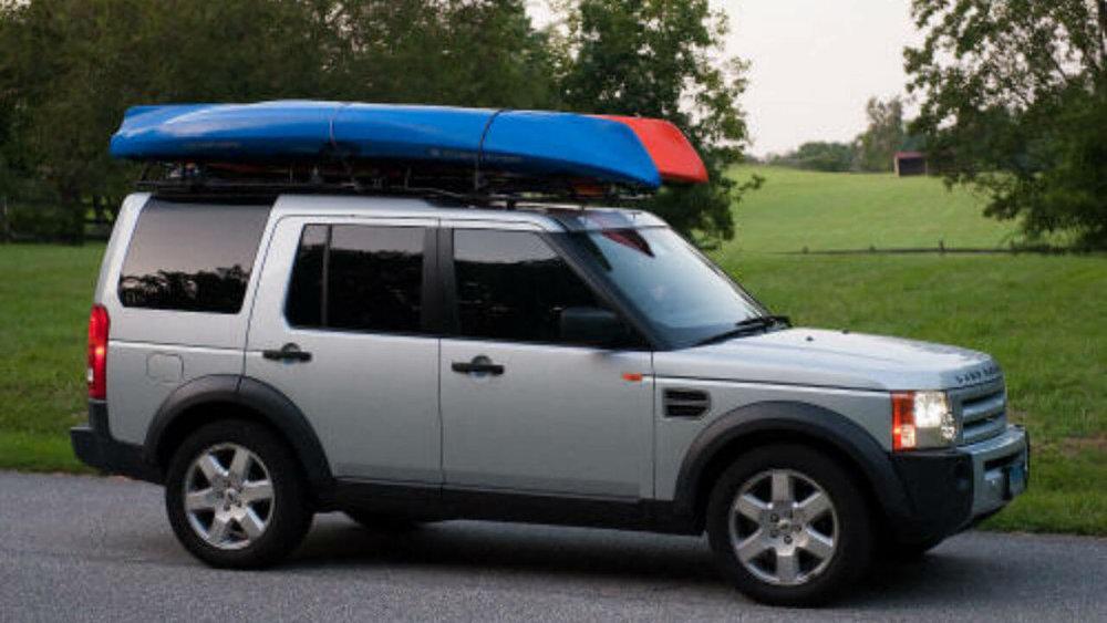 Land-Rover-LR3-Voyager-standard-roof-rack-kayaks-side-off-road-Voyager-Offroad.jpg