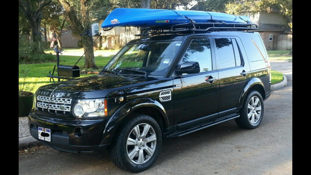 Land-Rover-LR3-low-profile-roof-rack-rock-sliders-extra-step-kayaks-on-top-off-road-Voyager-Offroad.jpg
