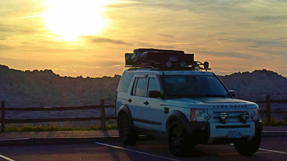Land-Rover-LR3-folded-campers-tent-edition-roof-rack-sunset-off-road-Voyager-Offroad.jpg