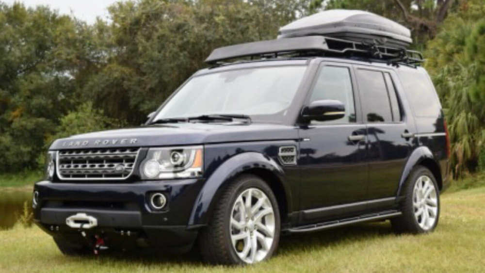 Land-Rover-LR4-hidden-winch-mount-skid-plate-rock-sliders-standard-off-road-roof-rack-Thule-box-Voyager-Offroad.jpg
