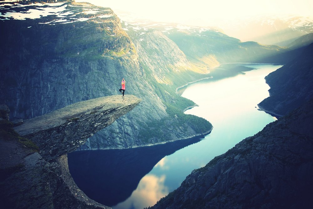 Yoga pose on Trolltunga cliff