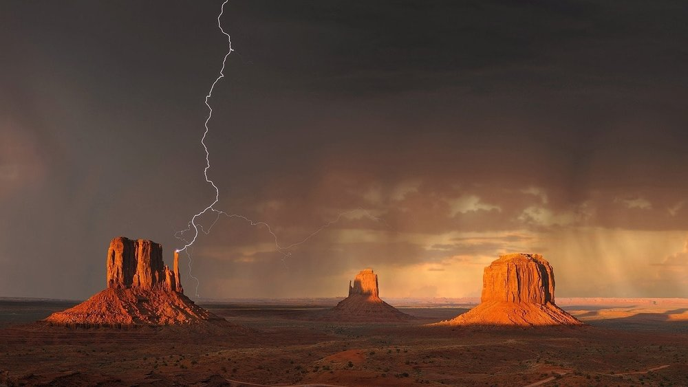 Lightning striking Monument Valley