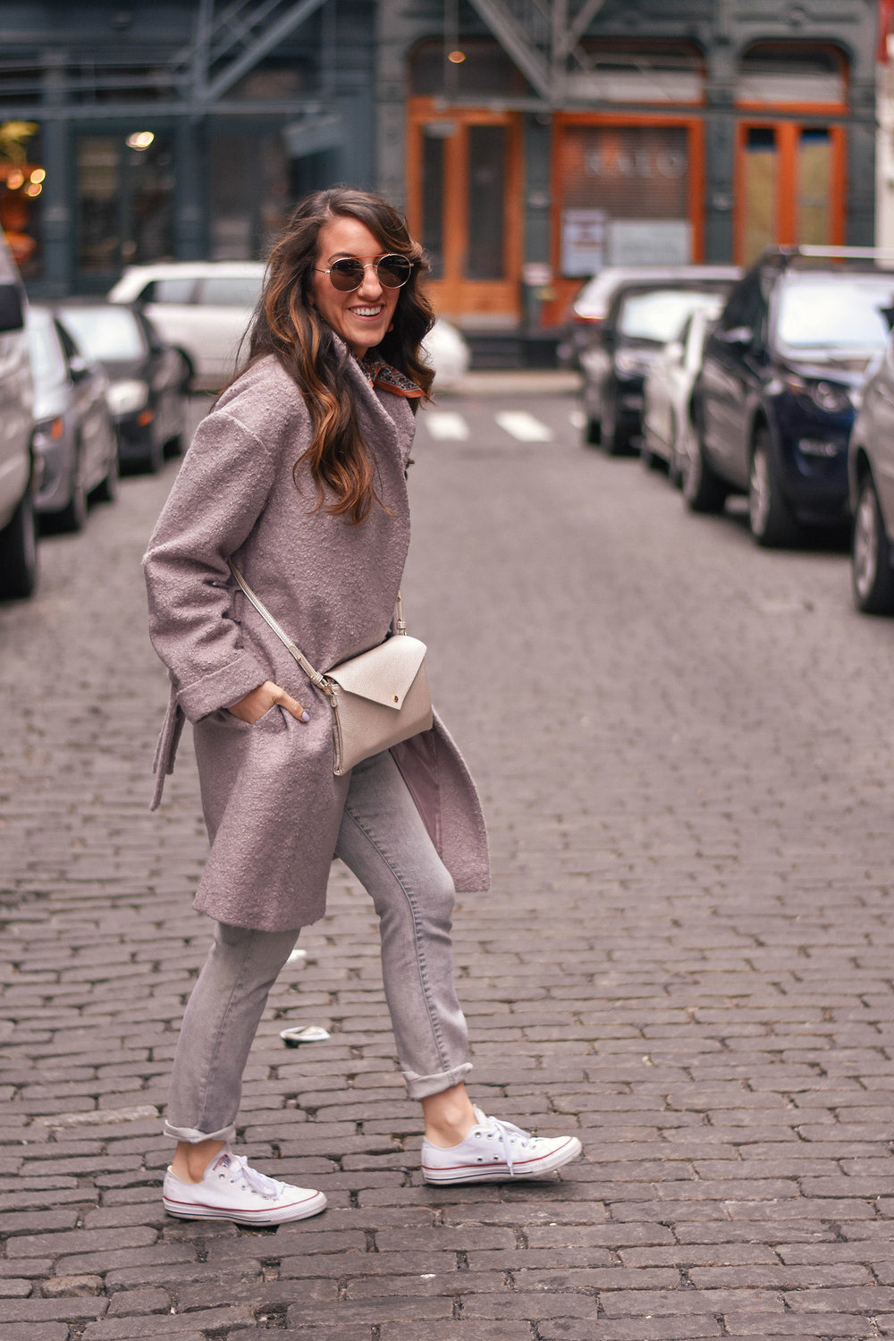 Asos coat [ similar ] //  Free People overalls  // Anthropologie tee [ similar ,  similar ,  love this graphic ,  feminine blouse ,  love this purple ] / bag [ similar ,  not similar but obsessed ] / sunnies [ similar ,  similar ,  splurge ] // Madewell scarf [ similar ,  similar ] / earrings [ cutie shapes ,  glitter ,  perfect for summer ] // Converse sneakers [ Nordstrom ,  Urban ,  this purple color is perfect for this look ] //