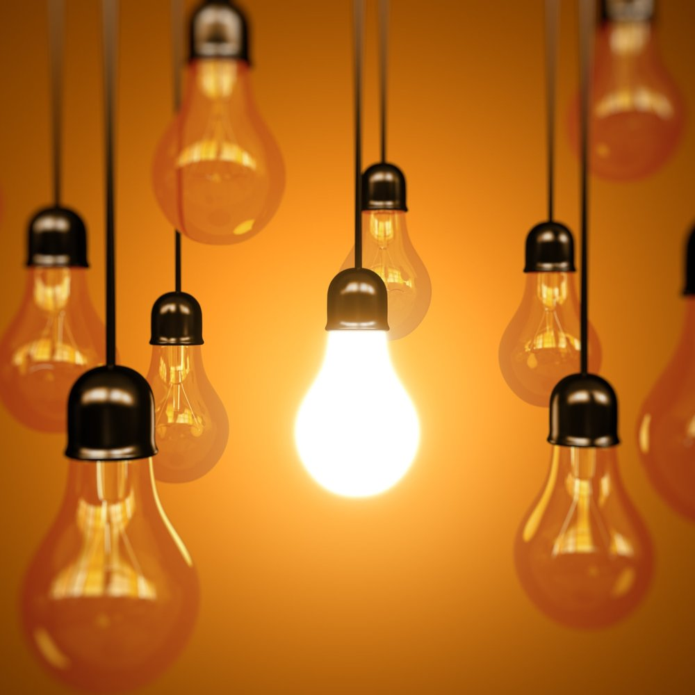 stock-photo-idea-and-leadership-concept-vintage-incandescent-edison-type-bulbs-on-color-wall-347800229.jpg
