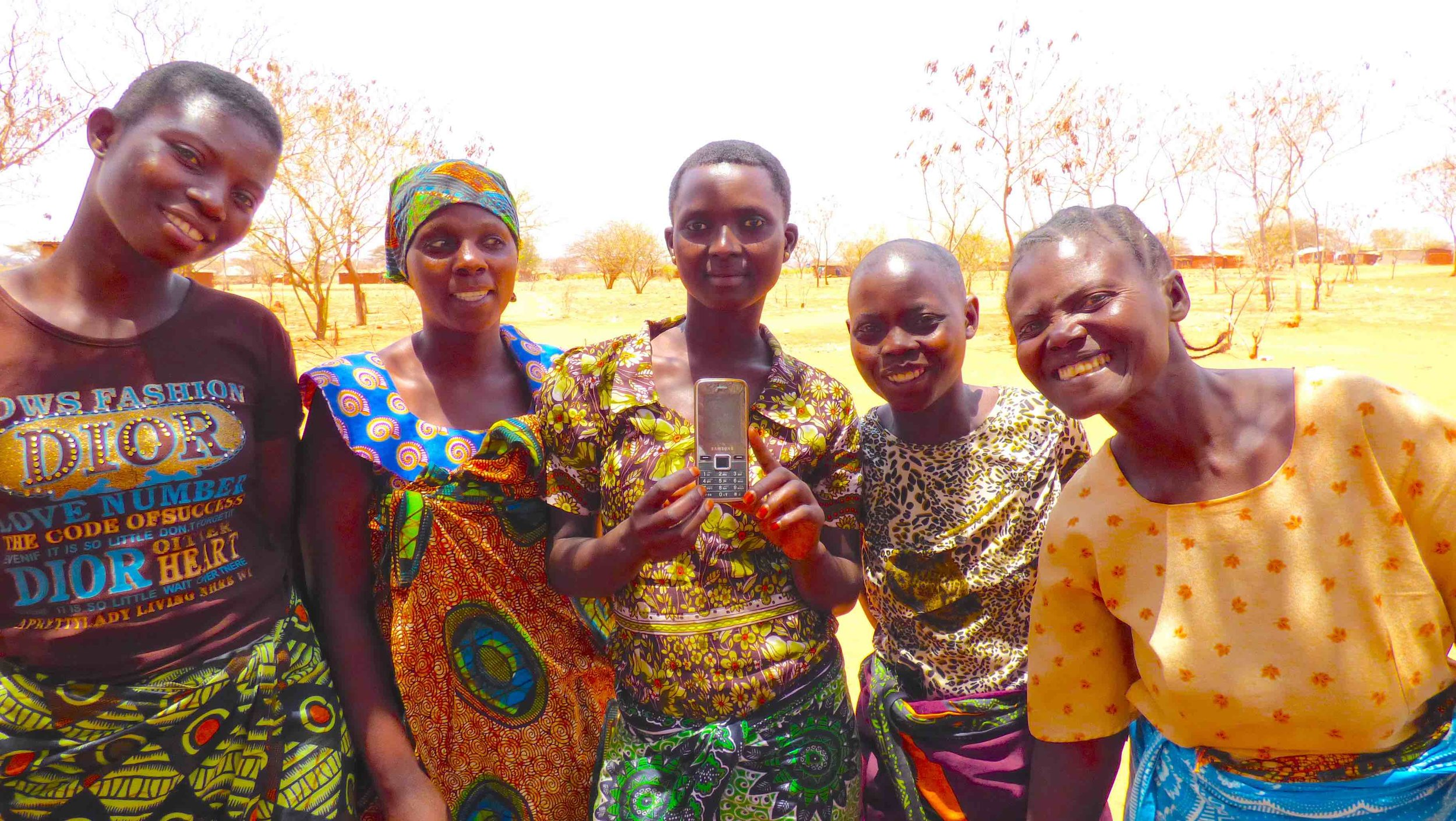 Tanzanian women with Self-Help Group facilitator and our savings and credit group Android mobile app (www.codeinnovation.com)