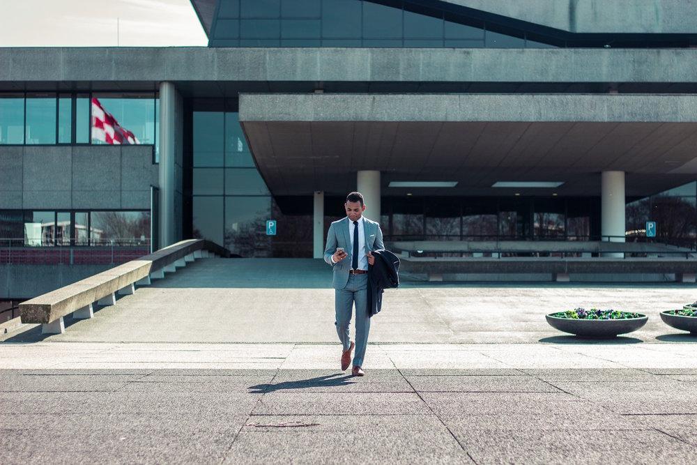 makemoves-design-business-web-design-editorial-photography-executive-man-leaving-building.jpg