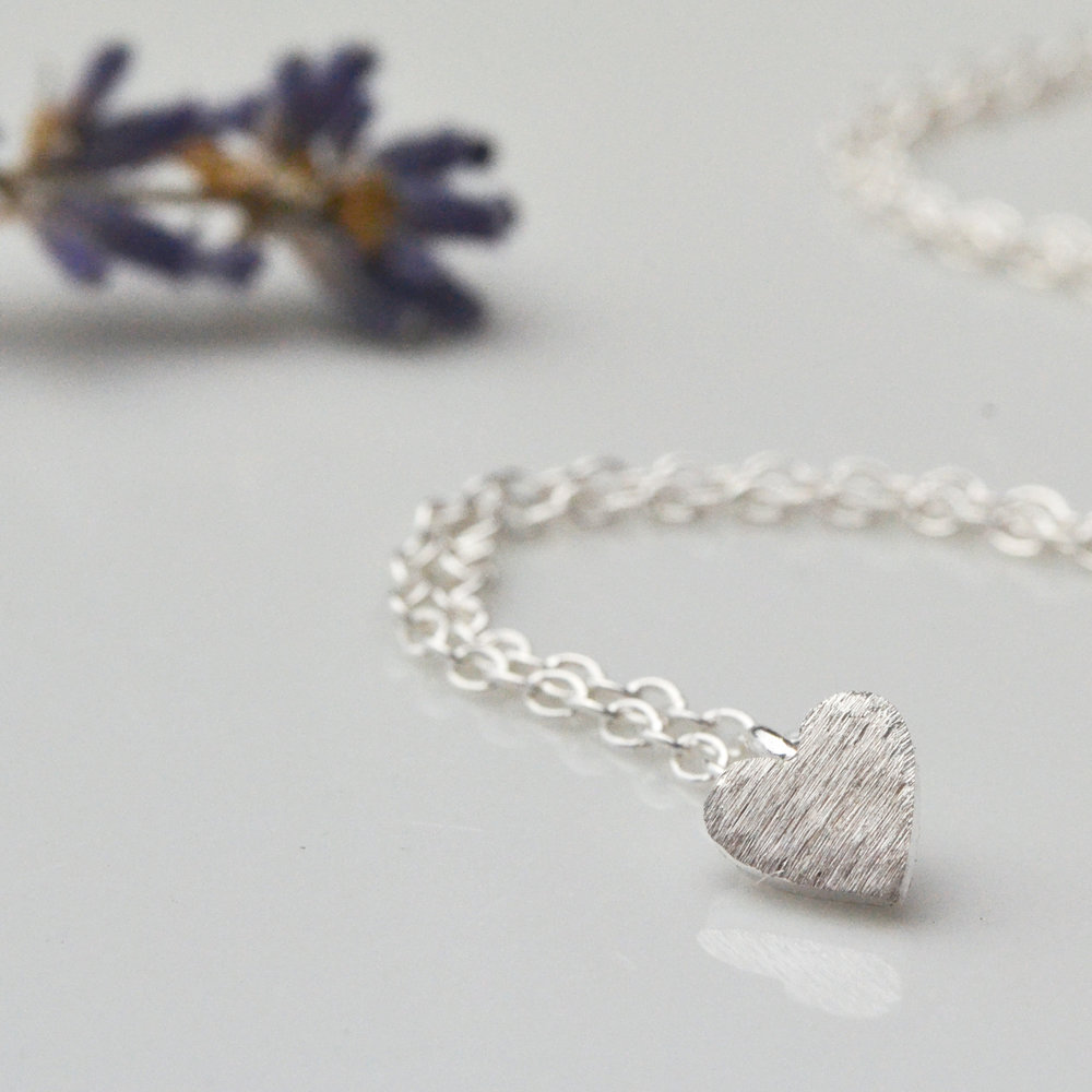 Teeny Silver Heart Pendant Necklace.  Just one of those go with everything necklaces that you can just wear all the time.