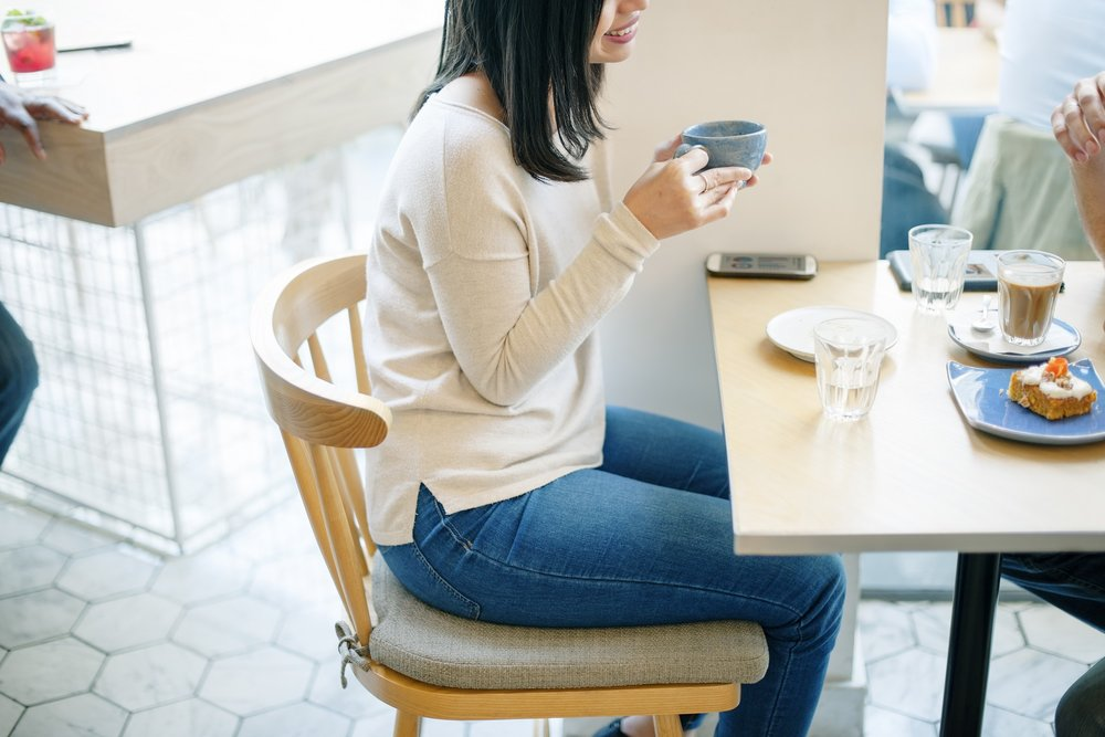 Asian woman drinking coffee with friend free image