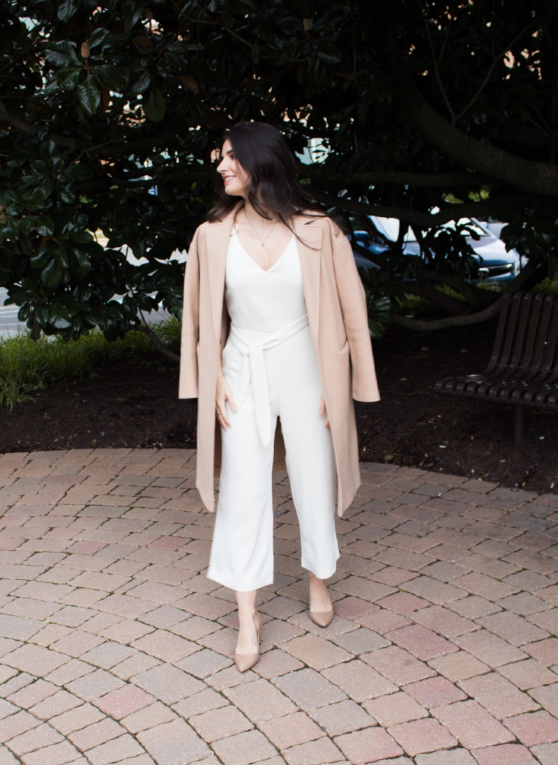 White jumpsuit with camel coat