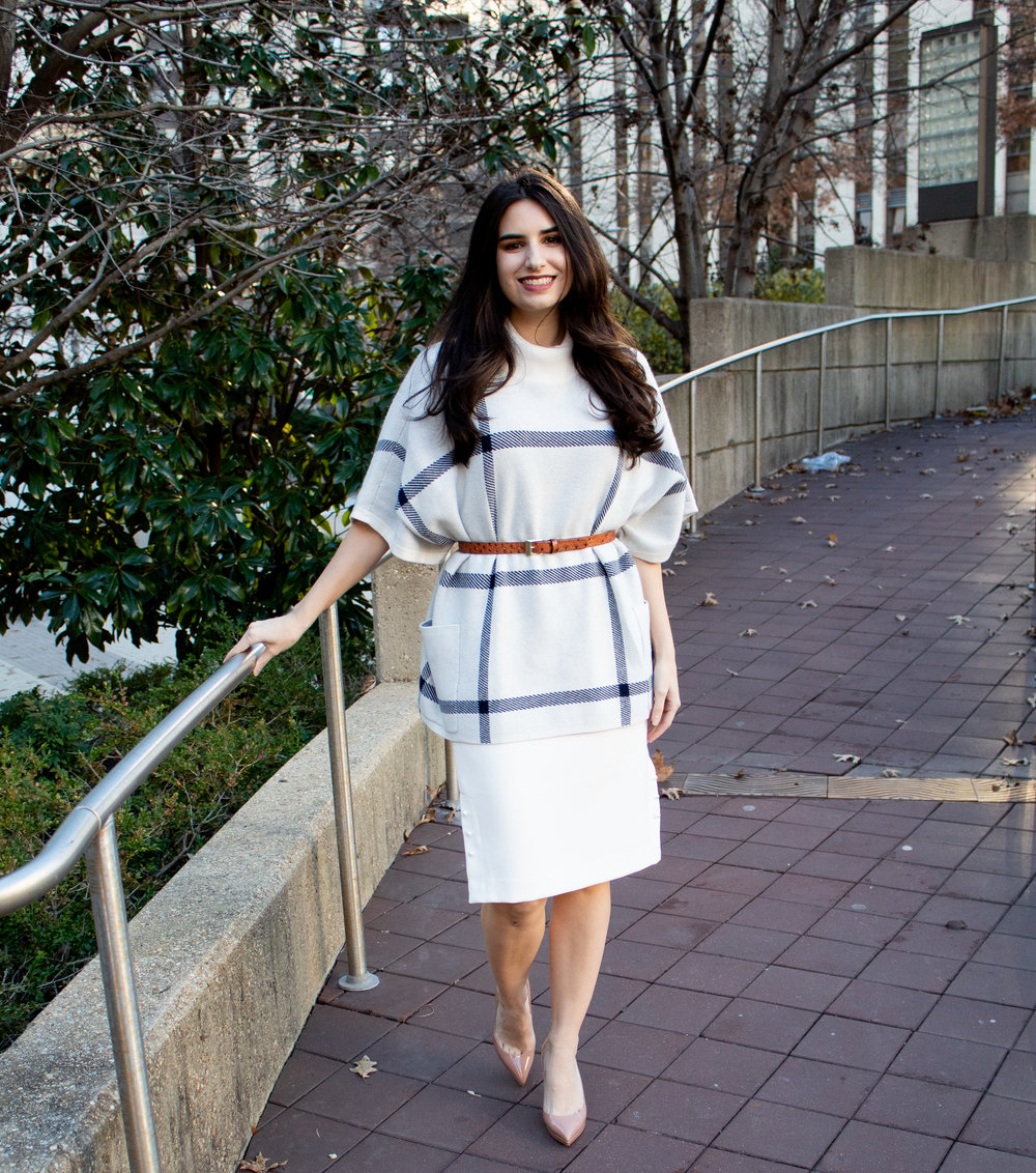 sweater poncho and white skirt