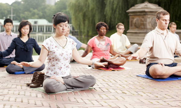 People practicing the Falun Gong meditation in a park. All classes are taught free of charge by volunteers in more than 70 countries around the world.  Image credit: faluninfo.net