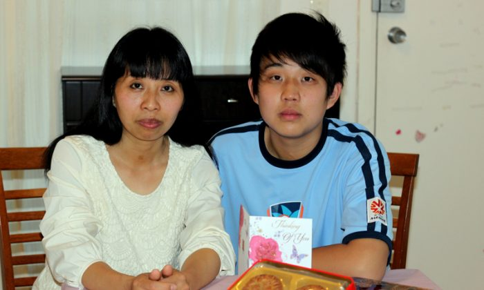 On Mid-Autumn Festival, Liu Chunli and her 15-year-old son Jia Mingzhen prepared a box of mooncake and a card for her husband Jia Ye, who is in a Chinese prison. They hope one day the family can celebrate the Mid-Autumn festival together. Picture: Epoch Times)