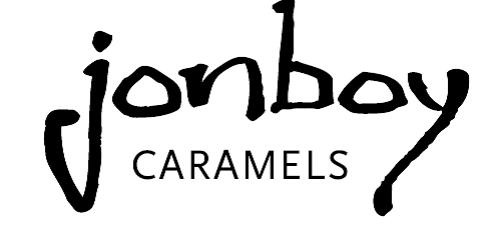 - Jonboy Caramels is an artisan confectionery company based in the Ballard neighborhood of Seattle, WA. In 2009, Jon Sue and Jason Alm came together with the idea of making the finest small batch caramels using the very best ingredients available. What started out as a side business, soon became a full time endeavor frequenting the bustling farmers market scene around Western Washington.