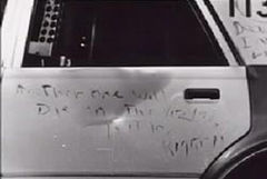 Message scrawled onto the side of a patrol vehicle.