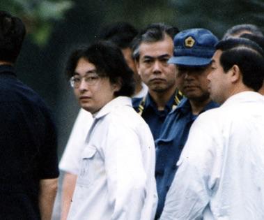 Miyazaki in handcuffs.