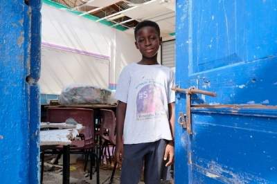 Photo credit: UNICEF/ENGLISH  Tiquani Lewis, 9 years old standing outside his school classroom in Anguilla