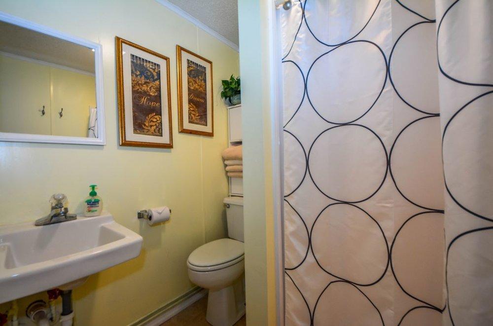 Shower, toilet & basin in dormitory.