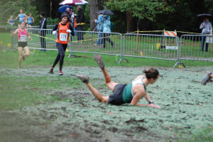 Danielle falling in the mud at the 2011 PA Championships.
