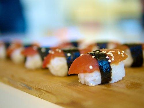 Ahimi™ served over rice, seaweed wrap and sesame seed garnish.