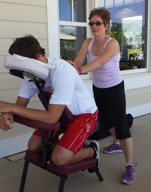 UVS volunteer Laura Balun provides a chair massage during a Memorial Day event