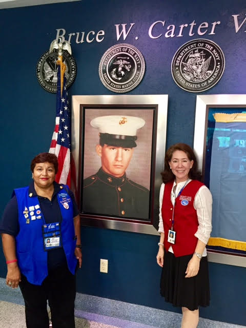 Pictured here (click photo to enlarge) at the Bruce W Carter VA Medical Center, Miami, FL is Maria Lacayo VAVS Rep. for UVS and Astrid Isom a UVS volunteer at the Greeter/Information Desk.